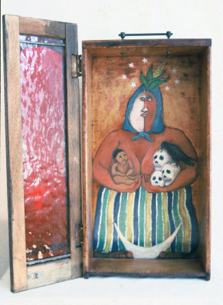 "Lammas Goddess, 1995, Oil on wood desk drawer with hinged ""door"" 22"" h x 19"" w x 5"" deep, Eleanor Ruckman  Lammas is a celebration of the harvest, so this Goddess is crowned with an ear of corn.  She embraces the cycle of life and death.  The white half of her face was originally a white-out stain."